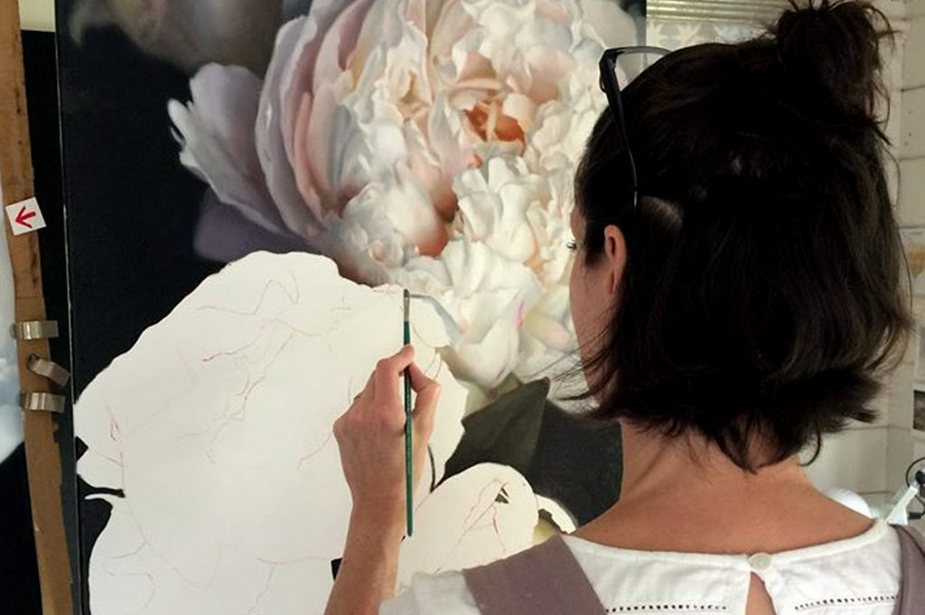 Caroline Richardson painting Floral Explosion in her studio